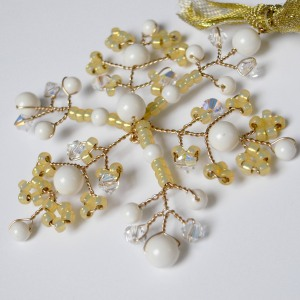 Snowflakes are delightful decorations for the Christmas tree and this is my second colour scheme - gold lined seed beads with Swarovski Crystal Pearls and crystals to add sparkle.