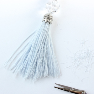 Trim across the bottom of the tassel to neaten the edges and adjust the length.