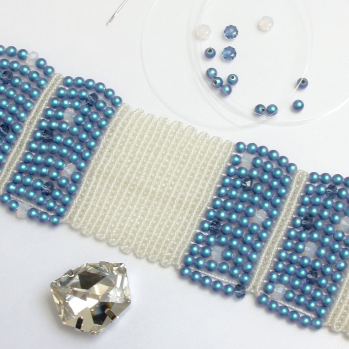Sew the tilted dice onto the cuff using nylon (illusion) thread