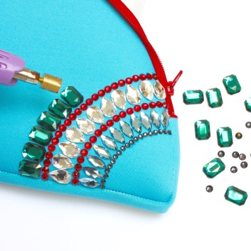 Add Emerald Cut hot fix Flat backs to a pouch or clutch bag